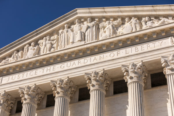 United States Supreme Court building, rear. Justice The Guardian of Liberty engraving.